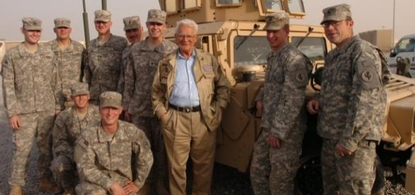 Easy Company WWII veteran Donald Malarkey visiting US troops in Iraq, 2008. (Photo Credit: Charles Mekin/Wikimedia Commons)