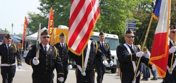 Veterans parading. Photo credit Cynthia Peterson-pixabay.com