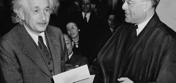 Albert Einstein receiving from Judge Phillip Forman his certificate of American citizenship. [image via Al. Aumuller, Wikimedia Commons]