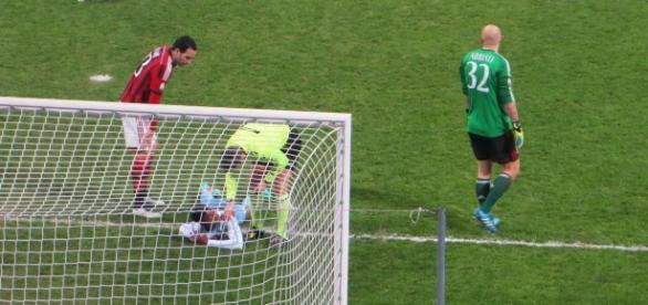 Lazio player on the ground injured in a past match. [Image Credit: Santosh Venkataraman/Flickr]