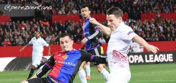 Basel midfielder Taulant Xhaka (Right) tackles Sevilla striker Rami Gameiro in a past match. (Image Credit: Perez-Ventana/Flickr)