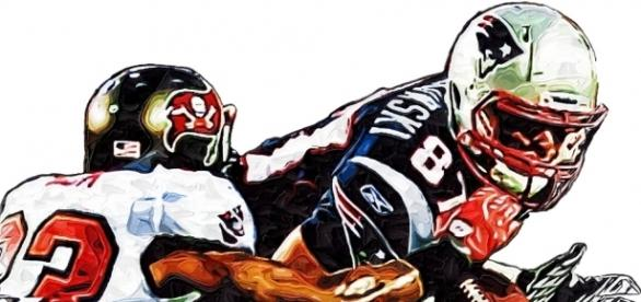 New England Patriots Rob Gronkowski - Tampa Bay Buccaneers Elbert Mack [Image by Jack Kurzenknabe|Flickr| Cropped | Public Domain Mark 1.0 ]