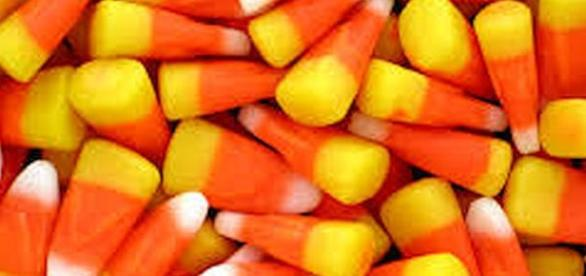 Candy corn is a popular Halloween candy [Image: commons.wikimedia.org]