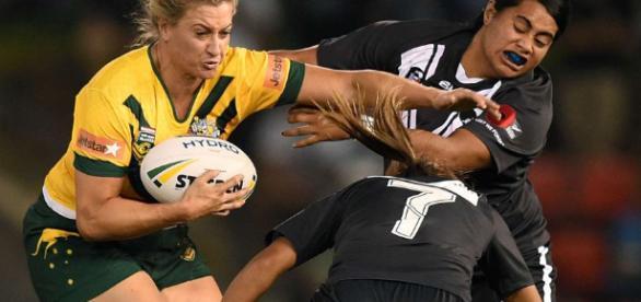 Australia captain Ruan Sims fends off two New Zealand players. Image Source: abc.net.au