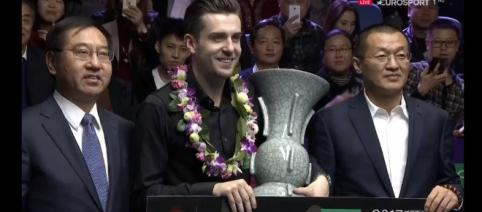 Mark Selby with the trophy in China holding a cheque for £150,000