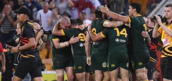 The Australian players rejoice as the final whistle blows in Brisbane. Image Source - bbc.co.uk