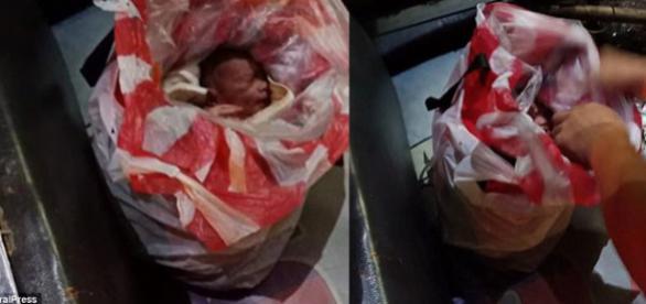 Un nou-născut abandonat a fost salvat în Filipine după ce a fost găsit într-o pungă de gunoi din plastic - Foto: Daily Mail (© ViralPress)