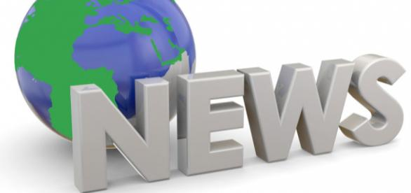 """A sign stating """"News"""" in front of a model of the world representing """"World News."""""""
