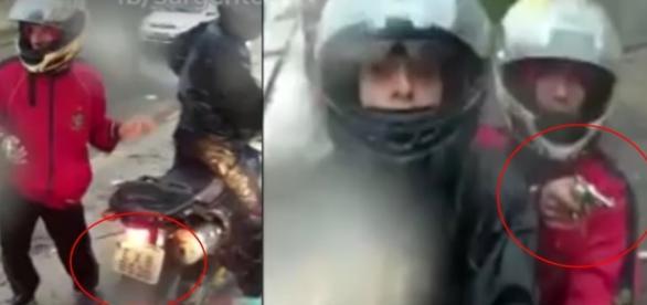Bandidos roubando moto em avenida