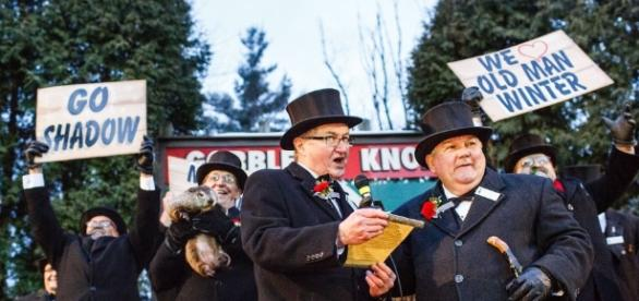 Weather forecaster Punxsutawney Phil hangs at back as his prediction is read. / Photo from 'Penn Live' - pennlive.com
