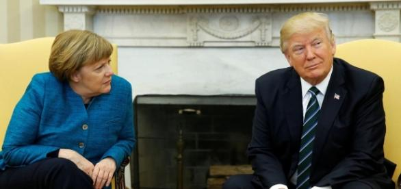 Awkward moment as Donald Trump 'IGNORES' Angela Merkel's offer of ... - mirror.co.uk