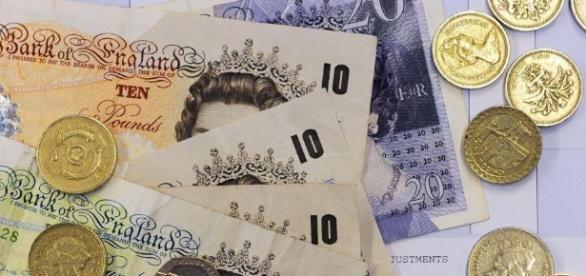 Marea Britanie majorează venitul minim garantat din aprilie 2017