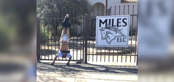 Tucson burglar hanging upside down on the fence