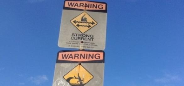 Warning sign for swimmers at Waimea Bay