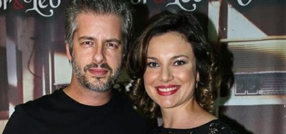 O cantor com sua esposa em um evento