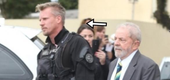 Policial gato escolta Lula - Google