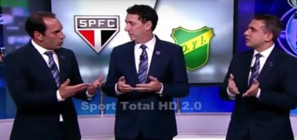Edmundo (à esquerda) perde a paciência com jornalista PVC (centro)