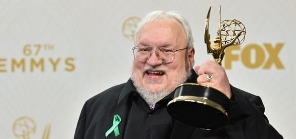 """George R.R. Martin holds his Emmy Award for Outstanding Drama Series for """"Game of Thrones."""" (via Alberto E. Rodriguez/Getty Images)"""