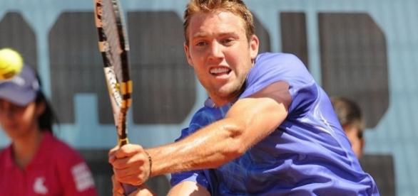 Jack Sock plays a backhand shot. Photo by Tatiana -- CC BY-SA 2.0)