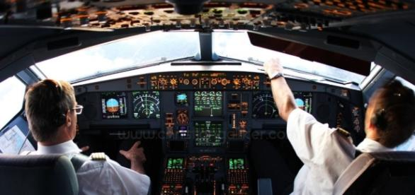 Pilot and co-pilot in cockpit.
