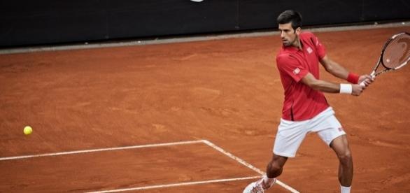 Novak Djokovic preparing to hit a backhand shot at the 2016 Rome Masters. Photo by Roberto Faccenda -- CC BY-SA 2.0