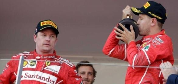 Kimi Raikkonen can't hide his disappointment as Sebastian Vettel beats him to Monaco glory. (Source: sportsnet.ca)