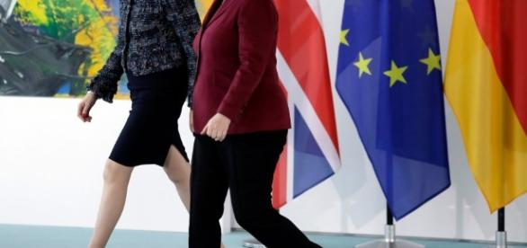 Theresa May puts pressure on Angela Merkel for quick deal after ... - thesun.co.uk
