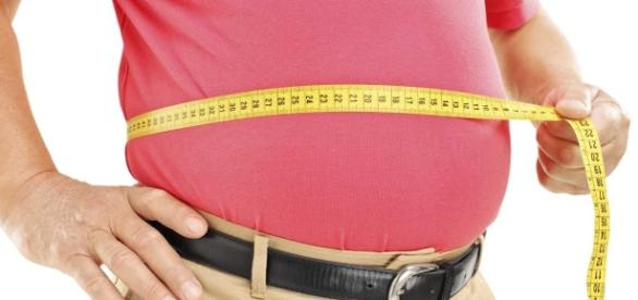 Middle age weight gain due to enzyme. Photo sourced via Blasting News library
