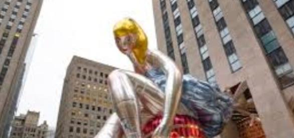 "Jeff Koons' ""Seated Ballerina,"" Rockefeller Center, NY. FAIR USE times.com Creative Commons"