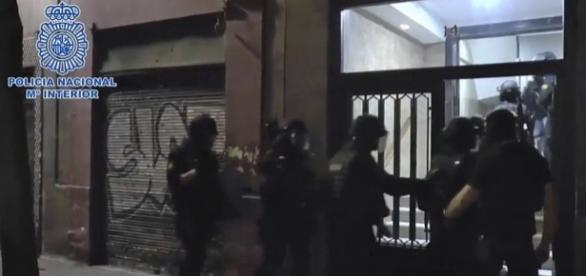 Photo Spain's National Police arrest 3 terror suspects in Madrid photo capture from YouTube/Policía