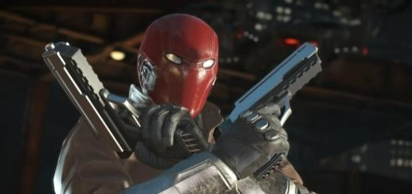 "Red Hood is set to arrive to ""Injustice 2"" alongside Starfire and Sub-Zero (via YouTube/Injustice))"