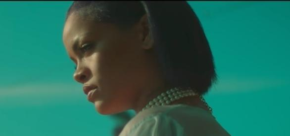 Singer Rihanna was recently seen making out in a pool with a mystery man stirring up fans' curiosity. [Image via Rihanna VEVO/YouTube]