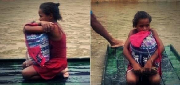 Foto de garotinha protegendo material escolar da enchente ganhou repercussão nacional