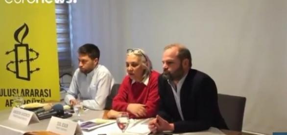 Members of Amnesty International Turkey. / [Image screenshot from Euronews via YouTube:https://youtu.be/T26Q_As7rYM]