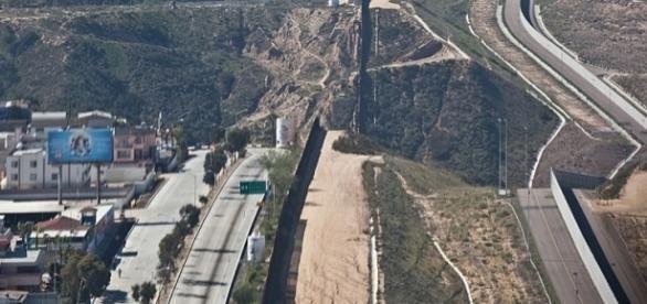 Border fence near San Diego (credit - Josh Denmark, wikimediacommons)