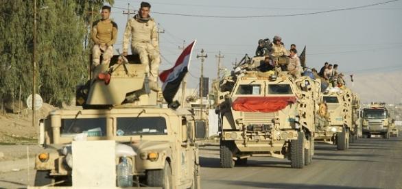 Iraqi Army convoy in Mosul   via Wikimedia Commons