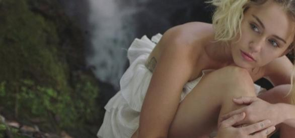 "Miley Cyrus in a screen shot from her ""Malibu"" music video - Flickr/Kurres Edlund"