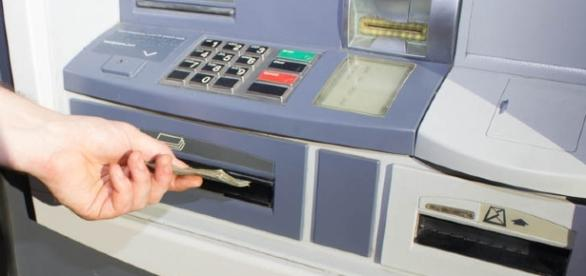 Man get trapped in an ATM / Photo via OTA Photos, Flickr