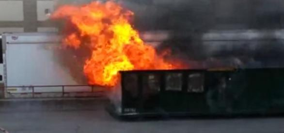 A dumpster fire in Brighton. / [Image Andy Dickason | YouTube]