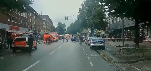 Police arrive at the scene of a stabbing attack in Hamburg [Image: YouTube/ IBTimes UK]