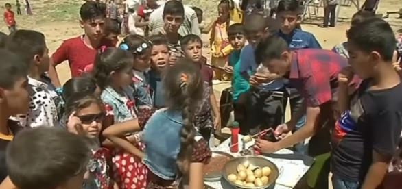 Children in Mosul celebrating Eid al-Fitr / [Image screenshot from Reuters via YouTube:https://youtu.be/YfTpAZgjdDE]