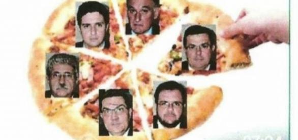 Pizza fatiada em seis pedaços mostra a foto de parlamentares