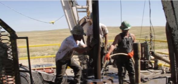 Drilling Rig Pipe Connection - gas prices drop in the USA - Image credit Calculated risk films | Youtube
