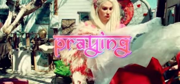 "Kesha's new song and video titled ""Praying"" (Youtube/keshaVEVO)."
