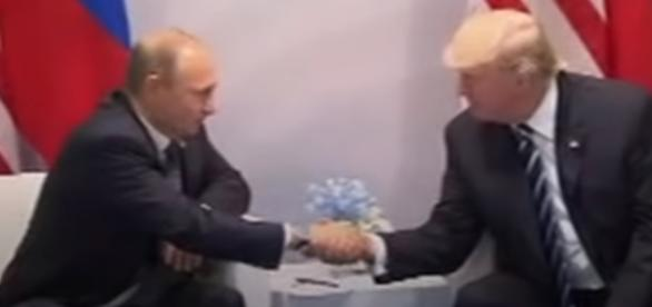 Trump and Putin meet and shake hands ahead of meeting at the G20 (Image credit Business Insider / Youtube