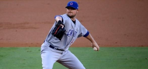 Cubs starter Jon Lester delivers a pitch during the first inning of #NLCS Game 5 by authorArturo Pardavila III via Wikimedia Commons