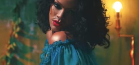 Rihanna's exboyfriend and close friend Drake defends her from Chris Brown. Image[Hollywood Life-YouTube]