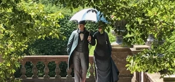 Two life-like sculptures seeming strolling along at Old Westbury Gardens. / Photo via the Seward Johnson Atelier, used with permission.