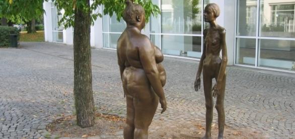 Overweight vs skinny sculpture via Wikimedia Commons
