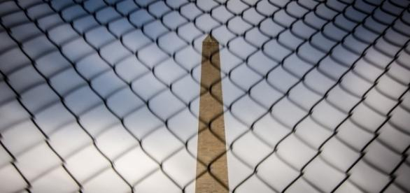 Washington Monument behind a fence in D.C. / [Image by M01229 via Flickr, CC By 2.0]